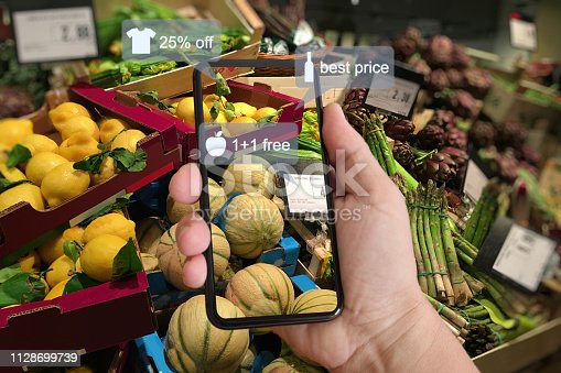 istock E-commerce augmented reality marketing in supermarket mobile phone app AI artificial intelligence 1128699739