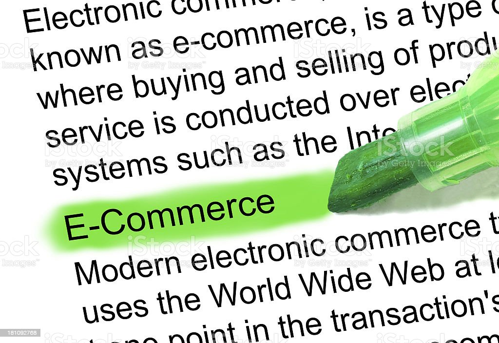 E-commerce definition highlighted in dictionary stock photo