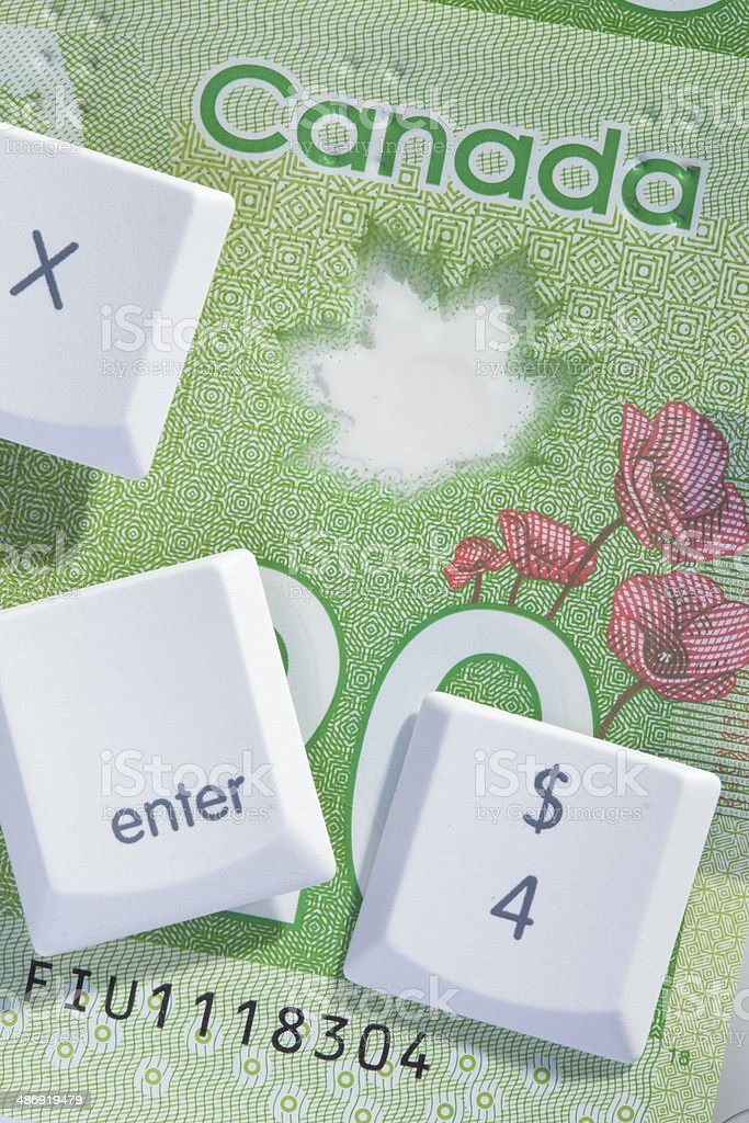e-commerce electronic banking;computer keys on us currency royalty-free stock photo