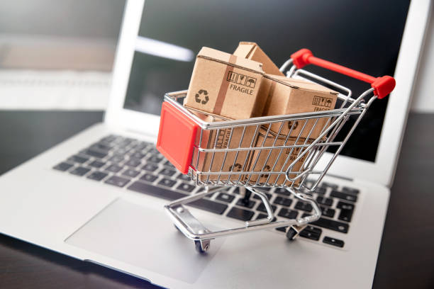 e-commerce, shopping trolley with paper boxes e-commerce, shopping trolley with paper boxes. Trade, selling via internet e commerce stock pictures, royalty-free photos & images