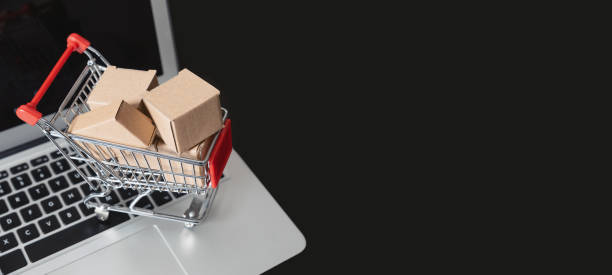 e-commerce, shopping trolley with paper boxes stock photo