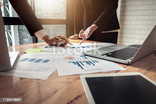 istock Economic business discussions, Business team analyzing income charts and graphs to plan marketing concept with using computer laptop and tablet for analysis. 1133478657