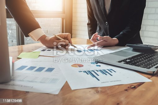 istock Economic business discussions, Business team analyzing income charts and graphs to plan marketing concept with using computer laptop and calculator for analysis. 1138125498