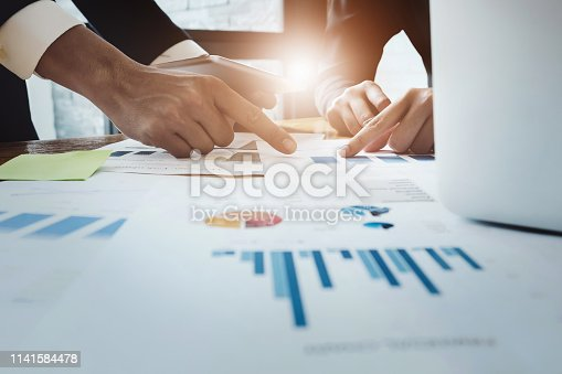 istock Economic business discussions, Business team analyzing income charts and graphs to plan marketing concept with using computer laptop for analysis. 1141584478