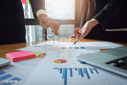 istock Economic business discussions, Business team analyzing income charts and graphs to plan marketing concept with using computer laptop for analysis. 1169195786