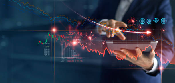 Economic crisis, Businessman using tablet analyzing sales data and economic graph chart that is falling due to the corona virus crisis, Covid-19, stock market crash caused. stock photo