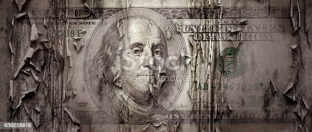 close up torn one hundred dollar bill