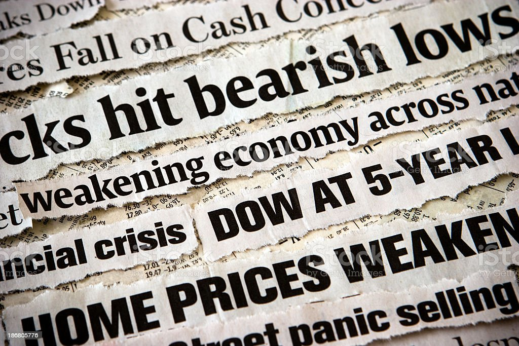 Economic headlines surrounding each other stock photo
