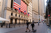 istock Economic recession is coming. 'Fearless Girl' Statue in front of the Stock Exchange from the Wall Street deserted because of the COVID-19 pandemic. 1217888015