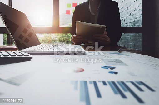 istock Economic research , Business woman analyzing income charts and graphs to plan marketing concept with using tablet and computer for analysis. 1150544172