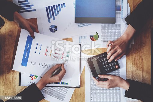 istock Economic research discussions, Business team analyzing income charts and graphs to plan marketing concept with using pen and calculator  for analysis. 1133413459