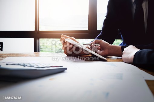 istock Economic research discussions, Business team analyzing income charts and graphs to plan marketing concept with using tablet and calculator  for analysis. 1133478718