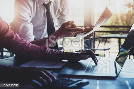 istock Economic research discussions, Business team analyzing income charts and graphs to plan marketing concept with using laptop computer and calculator  for analysis. 1134813093