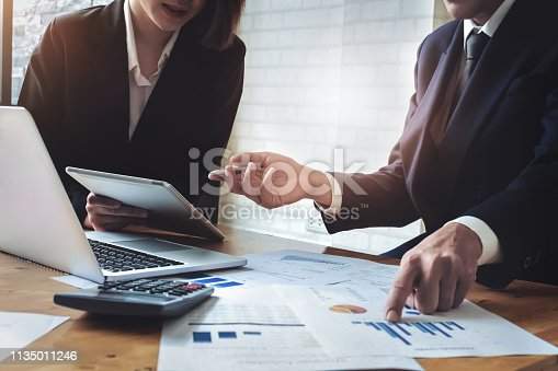 istock Economic research discussions, Business team analyzing income charts and graphs to plan marketing concept with using tablet and calculator  for analysis. 1135011246