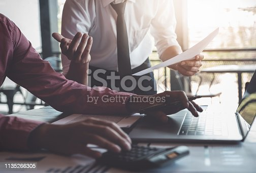istock Economic research discussions, Business team analyzing income charts and graphs to plan marketing concept with using laptop computer and calculator  for analysis. 1135266305