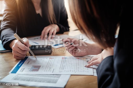 istock Economic research discussions, Business team analyzing income charts and graphs to plan marketing concept with using pen and calculator  for analysis. 1140078188