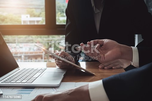 istock Economic research discussions, Business team analyzing income charts and graphs to plan marketing concept with using tablet and calculator  for analysis. 1147673390