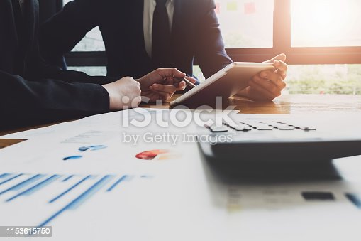 istock Economic research discussions, Business team analyzing income charts and graphs to plan marketing concept with using tablet and calculator  for analysis. 1153615750