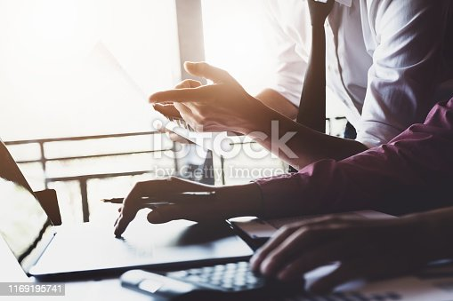 istock Economic research discussions, Business team analyzing income charts and graphs to plan marketing concept with using laptop computer and calculator  for analysis. 1169195741