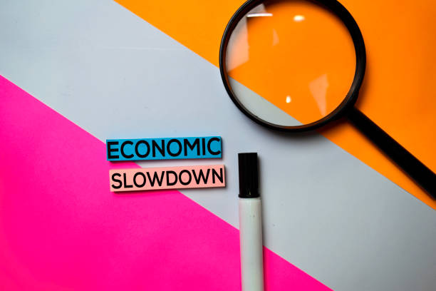 Economic Slowdown text on sticky notes with color office desk concept stock photo
