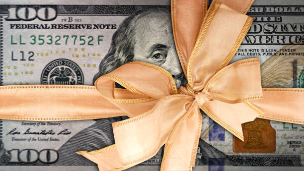 economic stimulus concept of American one hundred dollar gift stock photo