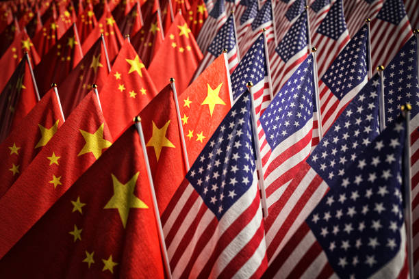 Economic trade war between the USA and China, partnership and diplomacy concept Many American and Chinese national flags together trade war stock pictures, royalty-free photos & images