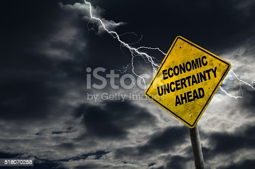 istock Economic Uncertainty Ahead Sign With Stormy Background 518070288