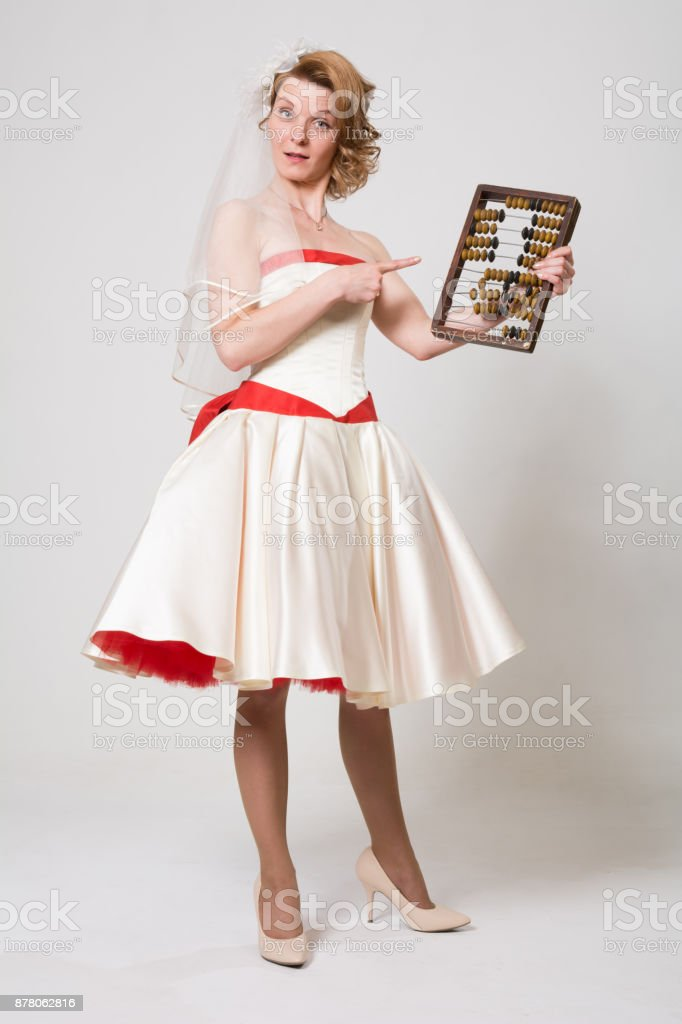 Economical bride with wooden retro bills stock photo