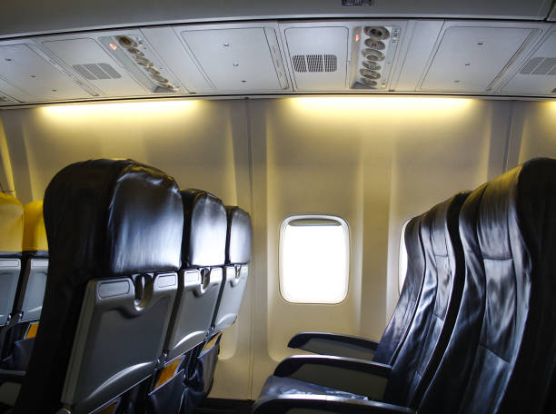 economy class seats for passengers on commercial aircraft. - covid flight imagens e fotografias de stock