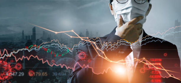 Economy crisis, Businessman with mask, Analysis corona virus economic impact, Crisis business and market financial conditions in the global Effects of outbreak and pandemic covid-19, Stocks fall. stock photo