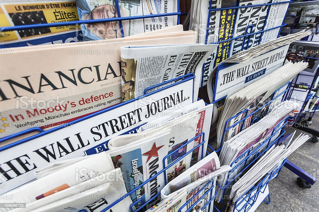 Economy Newspapers on a Newsstand royalty-free stock photo