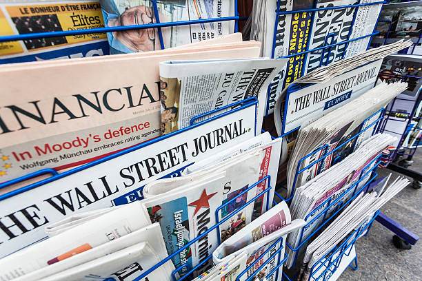 Economy Newspapers on a Newsstand stock photo