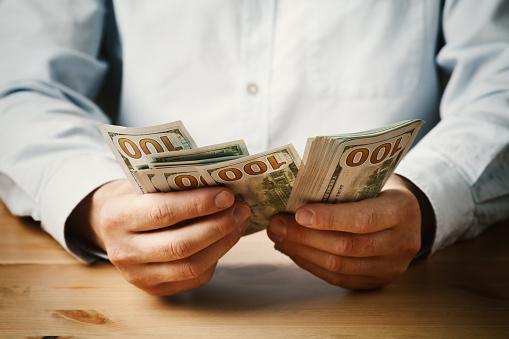 https://media.istockphoto.com/photos/economy-saving-salary-and-donate-concept-man-count-money-in-his-hands-picture-id821926900?k=6&m=821926900&s=170667a&w=0&h=CxAvZVcSjQ7mloM1k3eqZLZdtYRywVAQJpovfdDxGU8=