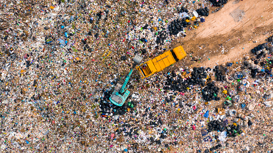 Ecosystem and healthy environment concepts and background, Garbage pile in trash dump or landfill, Aerial view garbage trucks unload garbage to a landfill, global warming.