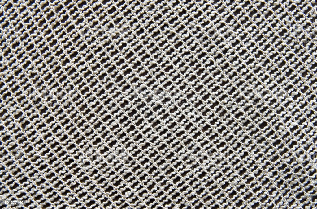 Ecru vintage lace with net fiber closeup on table stock photo