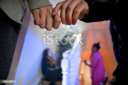 ecstasy being handed over at a house party