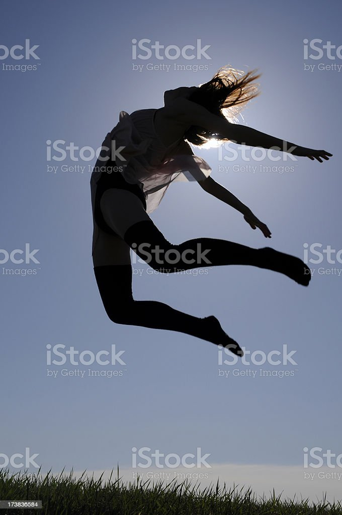 Ecstasy In Motion; Dancer Jumping royalty-free stock photo