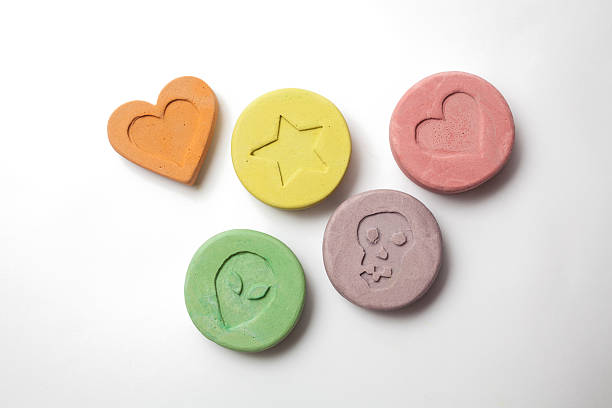 Ecstasy pills Ecstasy tablets on white background deathly stock pictures, royalty-free photos & images
