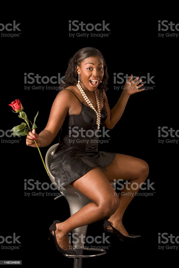Ecstatic African-American woman with rose flower royalty-free stock photo