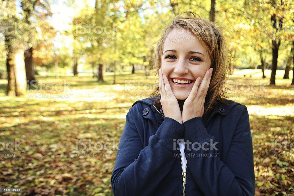 Ecstatic Blonde Caucasian Girl in Autumn Park royalty-free stock photo