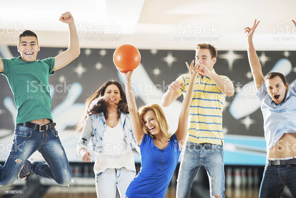 Ecstatic bowling team with raised hands. royalty-free stock photo