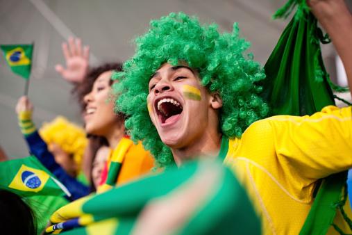 Ecstatic Brazilian fan watching a football game
