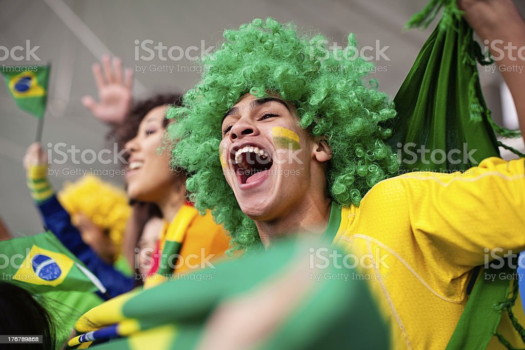 Ecstatic Brazilian fan watching a football game stock photo