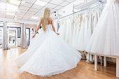 Ecstatic bride dancing in bridal shop