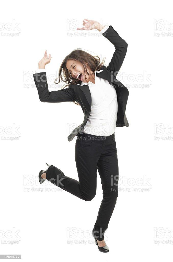 ecstatic businesswoman in suit dancing stock photo