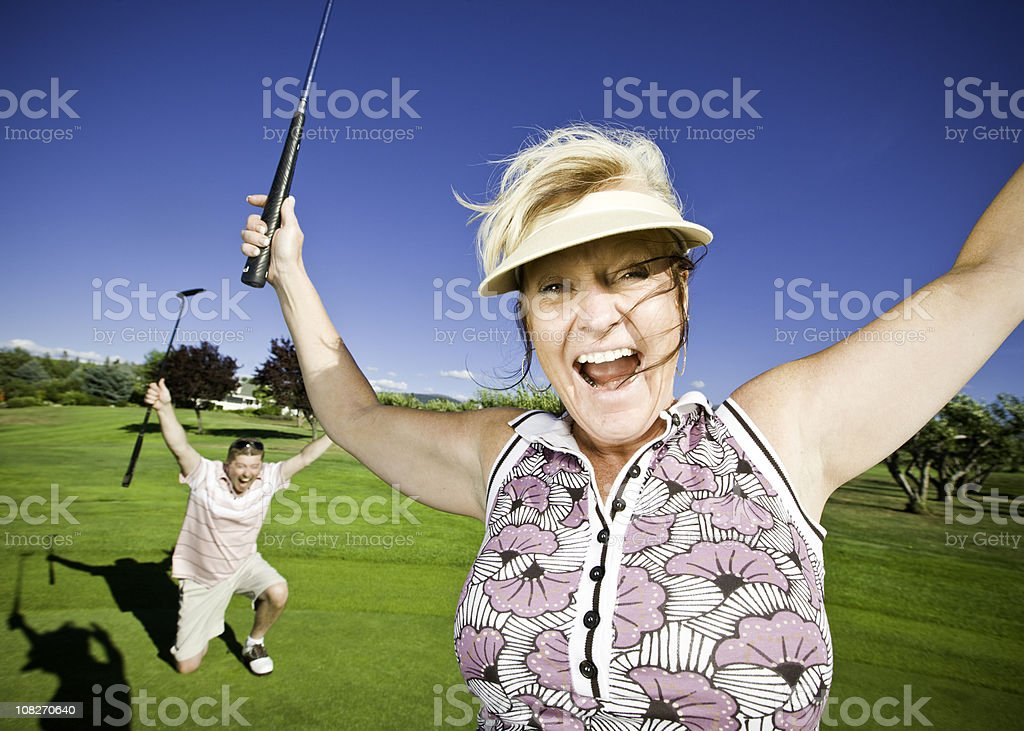 Ecstatic Couple on the Golf Course royalty-free stock photo
