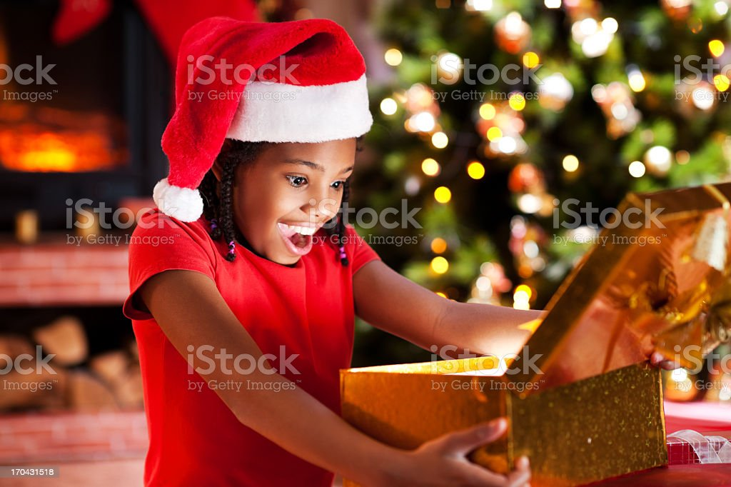 ecstatic girl opening christmas presents royalty free stock photo
