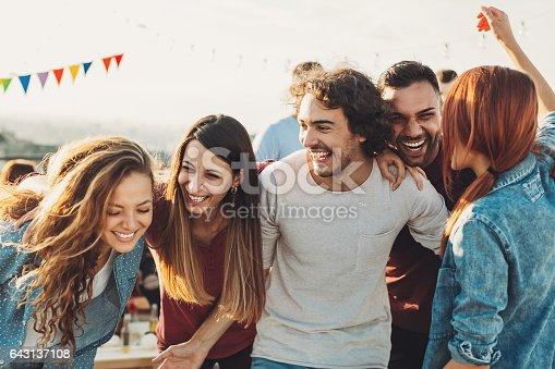 istock Ecstatic group enjoying the party 643137108