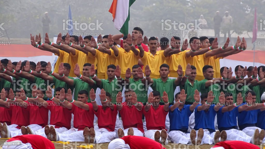 group of ecstatic people performing gymnastic activity during sports...