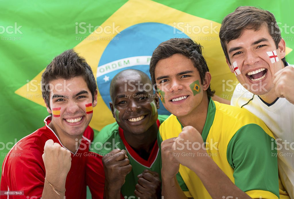 Ecstatic group of soccer fans stock photo